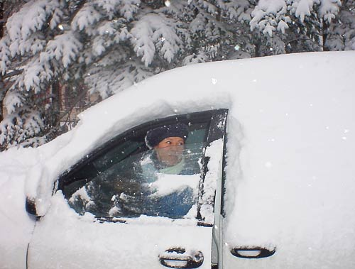 driver in snow covered vehicle