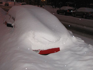 car buried under snow parked on a montreal street
