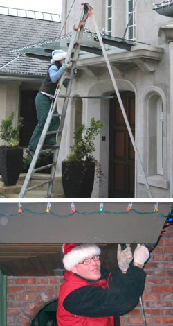 on a ladder installing christmas lights