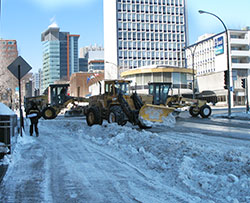 snow removal equipment blocks a busy montreal intersection