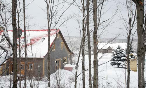 a sugar shack in a snowy quebec forest