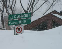 snow so deep that it buries city street signs